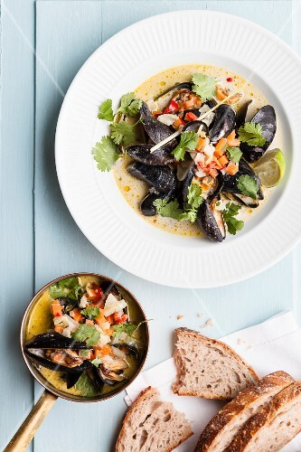 Steamed mussels with beer, coconut, vegetables, coriander and limes