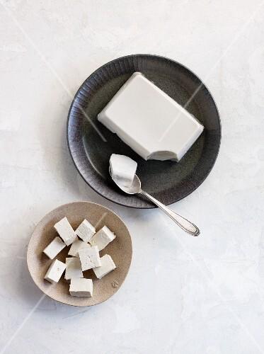 A block of tofu and diced tofu