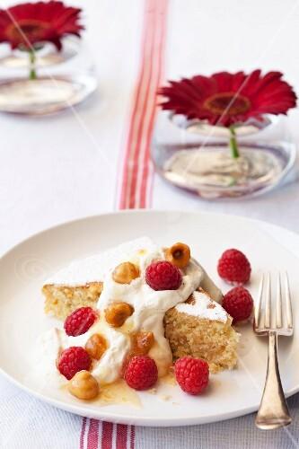 Hazelnut cake with vanilla cream and raspberries