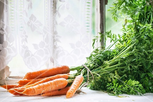 Fresh carrots on an old window sill