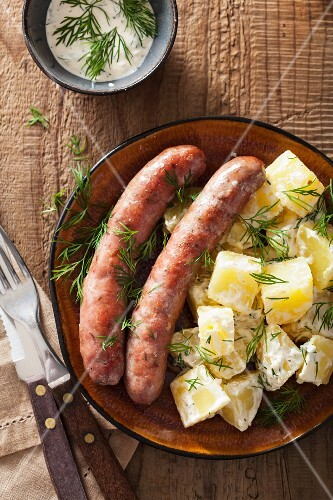 Sausages with potato salad and dill
