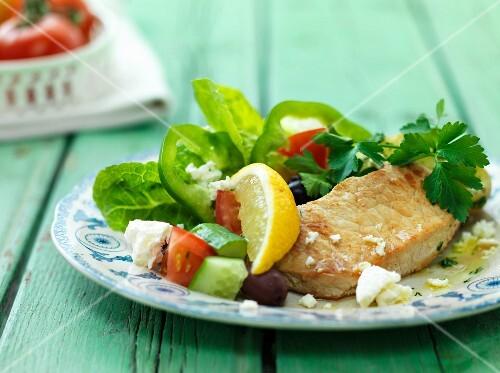 Pork escalope with a Mediterranean salad