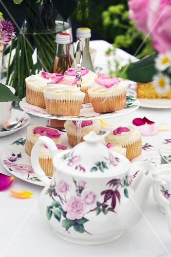 Rose petal cupcakes on a table laid for tea