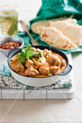 Chicken meatball curry with naan bread