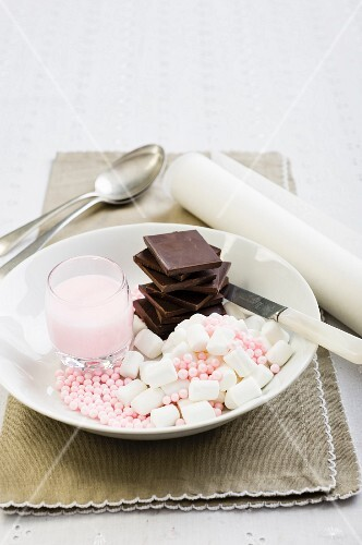 An arrangement of sweets and icing sugar