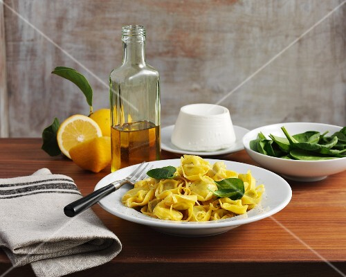 Tortellini with lemons, rocket and spinach