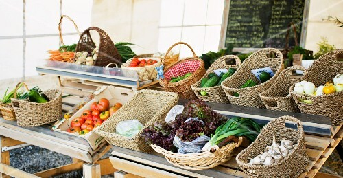 Baskets of vegetables on a market stall