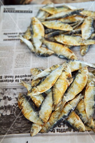 Fish on newspaper at a market in Margao, Goa, India