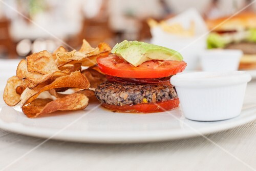 A quinoa burger with tomato and avocado in a cafe in South Beach, Miami, Florida