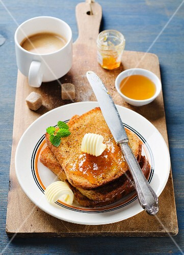 French toast with butter and jam served with coffee