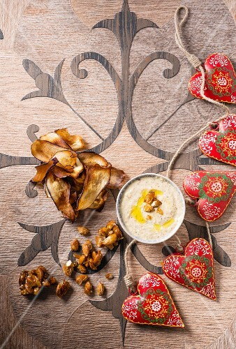 An almond dip with aubergine crisps and caramelised onions