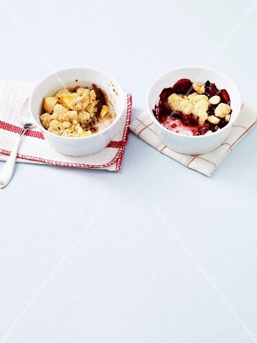Two sweet fruit bakes topped with crumbles