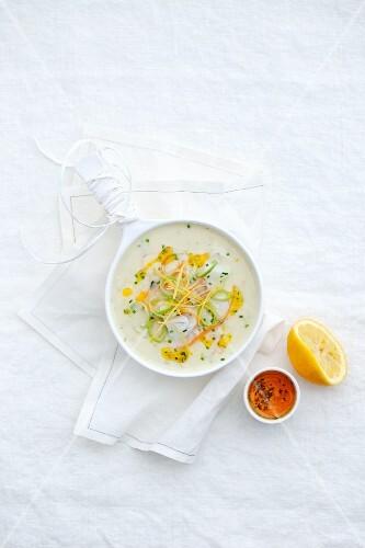 Fish soup with orange and lemon zest