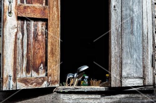 A view through the kitchen window of a wooden hut, Bangkok