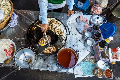 Fried noodles being made (a market stall in Bangkok)