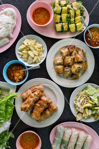 Various dishes (pork dumplings, vegetables, spring rolls) from Laos