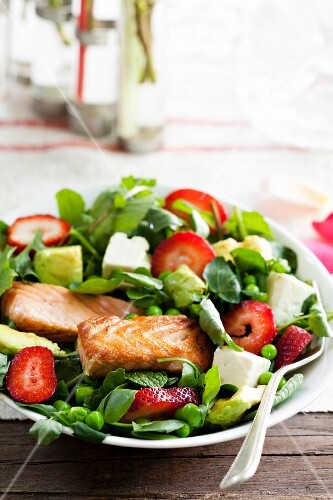 Salmon fillet on a strawberry and mint salad