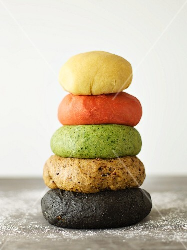 A stack of various coloured pasta dough