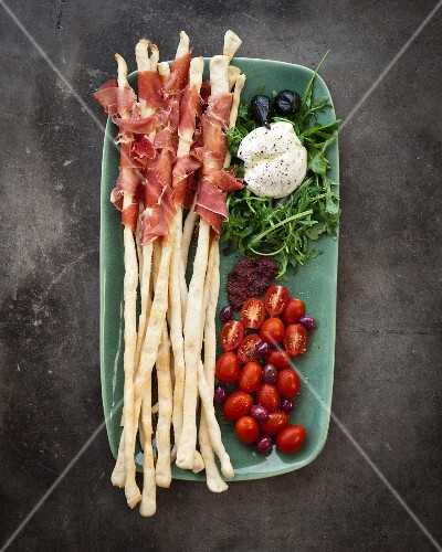 Grissini with Parma ham, tomatoes, mozzarella and rocket