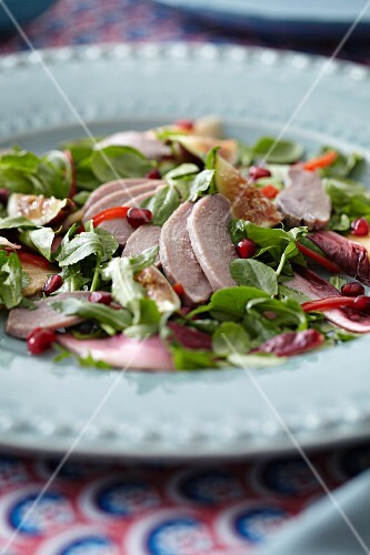 Herb salad with meat and fruit