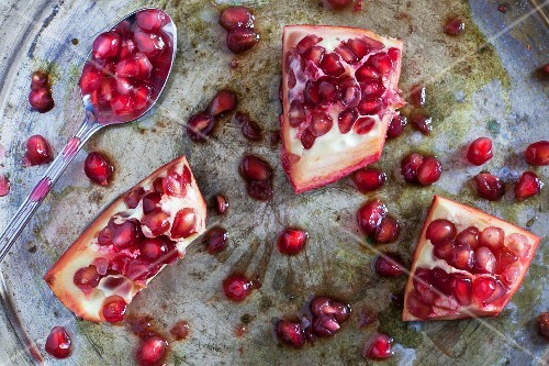 Sliced pomegranate on a silver tray