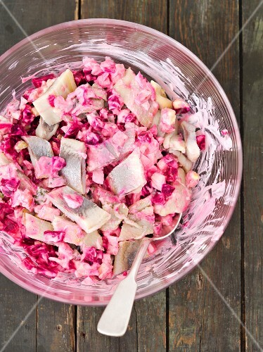Herring salad with beetroot, gherkins, egg, apple and mayonnaise