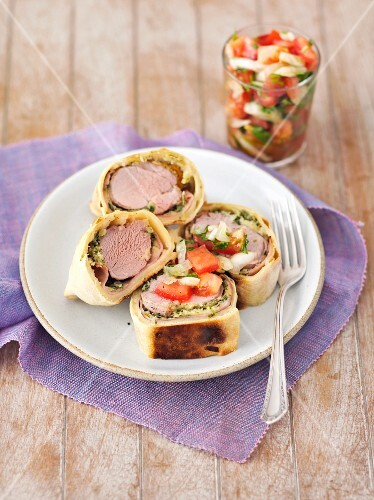 Pork fillet wrapped in puff pastry with a tomato salsa