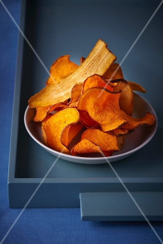 Various different vegetable crisps on a plate