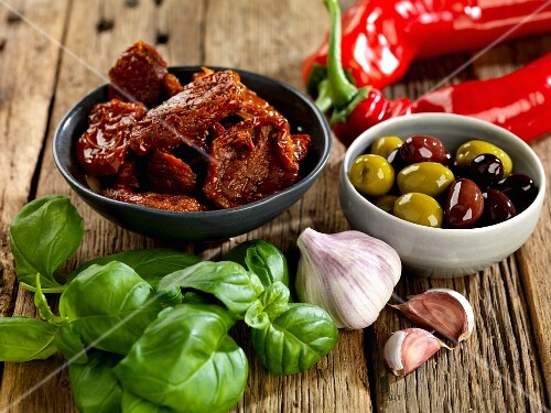 Dried tomatoes, olives, basil, garlic and chilli peppers