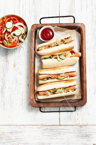 Hotdogs with gherkins, ketchup and onion relish