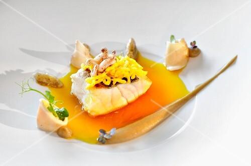 Sea bass with puffed saffron rice, aubergines and calamaretti