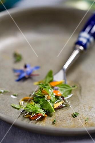 Wild herb salad on a fork