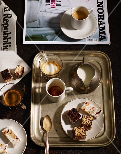 Coffee, milk and nougat on a tray