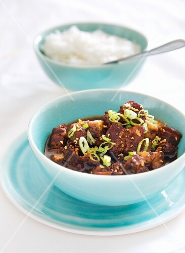 Pork belly in a caramel and soy sauce served with rice (Asia)