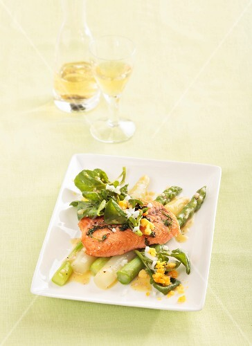 Salmon fillet on an asparagus salad