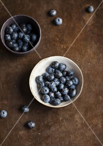 Two bowls of fresh blueberries