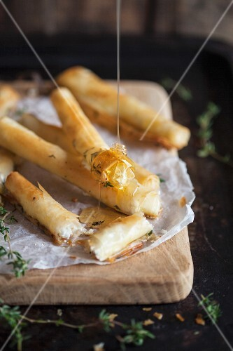 Puff pastry rolls filled with cream cheese, honey and thyme