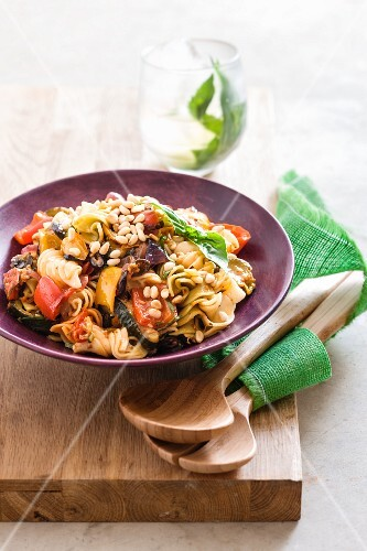 Noodles with grilled vegetables and pine nuts