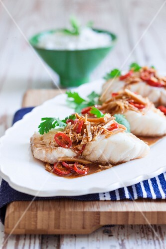Steamed fish with a ginger and soy sauce and chillis
