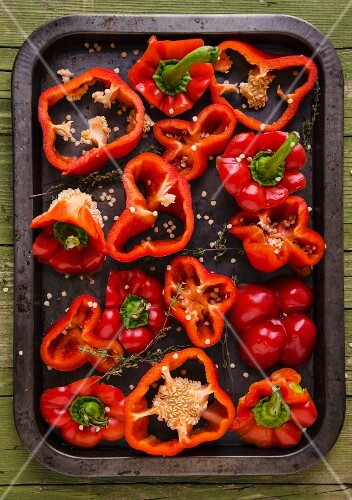 Sliced red peppers on a baking tray