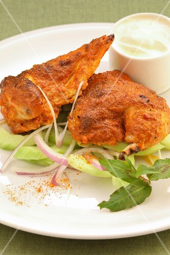 Tandoori chicken with a cucumber salad and yoghurt