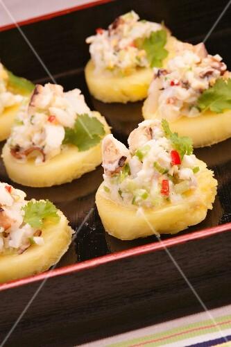 Crab salad on pineapple slices