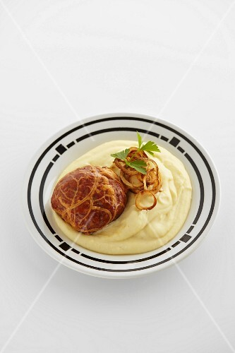 Saumaise (cured pork meat loaf from Austria) with mashed potatoes and onion rings