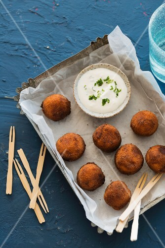 Deep-fried cheese balls with a dip