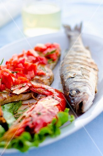 Grigliata Mista fish platter with grilled sea bass, prawns, swordfish and sepia (Italy)