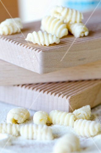 Handmade Sardinian gnocchetti (malloreddus) on wooden moulds