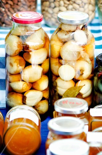 Jars of pickled English onions at a market