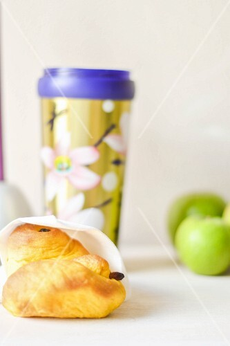 A breakfast pastry and tea to go