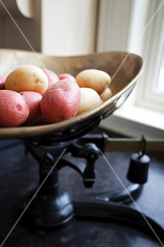 Various potatoes on an old pair of kitchen scales