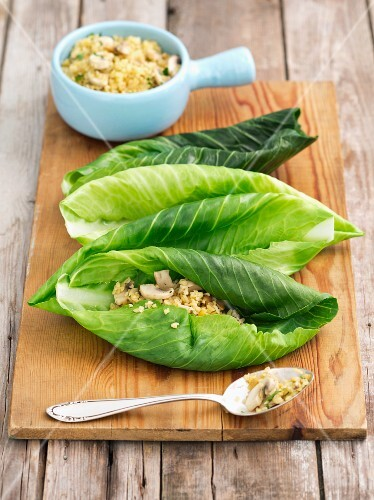 Young white cabbage leaves with a bulgur and mushroom filling (uncooked)